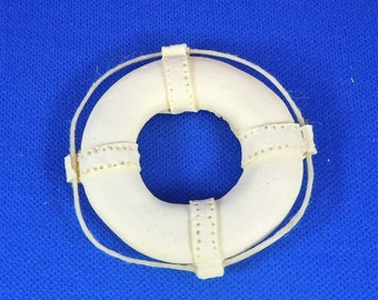 Dollhouse Miniature accessory in twelfth scale or 1:12 scale.  Life preserver.  Item #D486.
