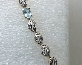 Sterling silver with gold overlay blue topaz stones.