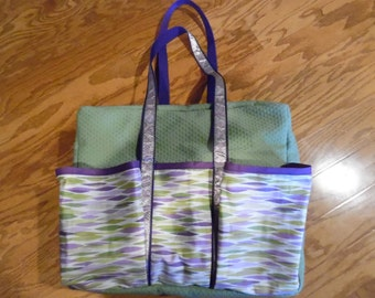Green & purple dance bag with outside pockets large enough to hold shoes or water bottle