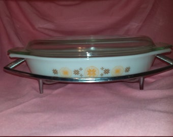 Vintage Pyrex Town And Country divided casserole dish with lid and metal stand.