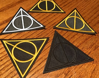 Embroidered Deathly Hallows iron-on patch inspired by Harry Potter. Black, Gold, or White.