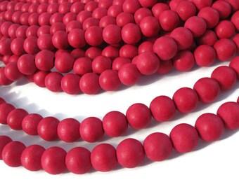 Perles rondes en bois naturel teint rouge cerise 10mm - 40 unités