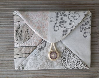 Envelope in beige fabric with hearts