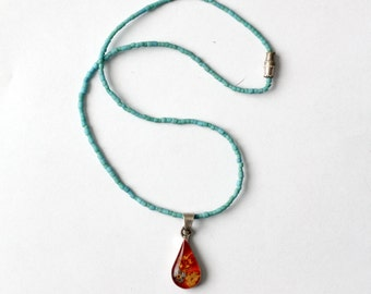 vintage pressed flower pendant necklace with turquoise strand