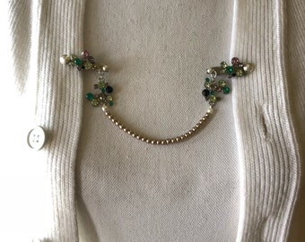 Caridgan/ sweater/ collar clips.