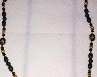Vintage Japan floral motif tensa 26 inch long necklace with fluted gold beads
