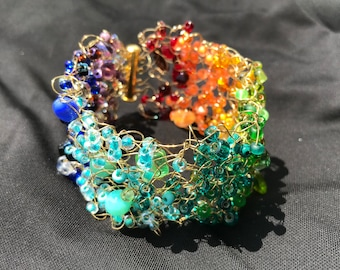 Rainbow and gold beaded knit cuff bracelet
