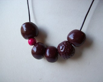 Polymer clay beaded necklace. Brown polymer clay round beads.Candy pink wooden bead.Leather cord.