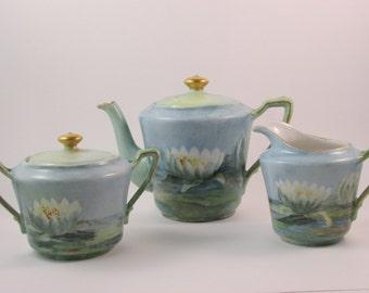 Antique KPM Tea Set Teapot Cream Pitcher and Sugar Bowl Hand Painted Lotus Flower Design