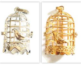 Birdcage bird cage and bird in shiny silver or goldtone 40x26mm