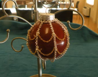 Glass christmas ornament with chainmail