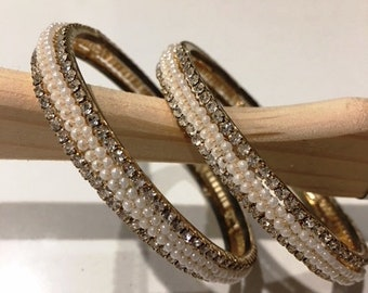 Glittering bangles with mini pearls and white stones