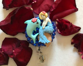 Mermaid and dolphin badge reel