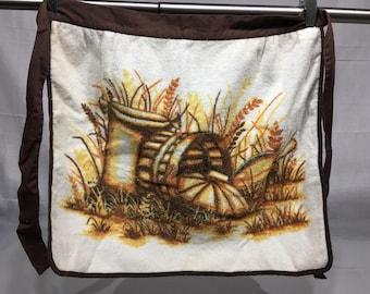 Vintage half apron with orange and yellow stripes, ceramic jugs with flowers. Retro Kitchen, Retro half apron, kitchen towel,