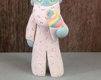 Yeti with rainbow snow cone figurine/ornament