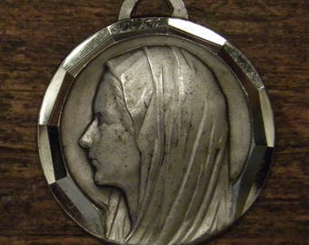 Antique religious alpacca silver medal pendant of the holy mother Mary of Lourdes