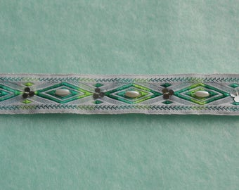 Green and white stripe embroidered geometric patterns and beads