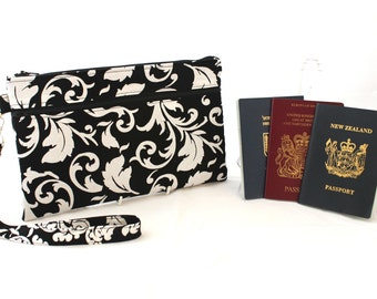 family passport holder - travel document organizer - multiple passport holder - family travel wallet - passport and boarding pass wallet