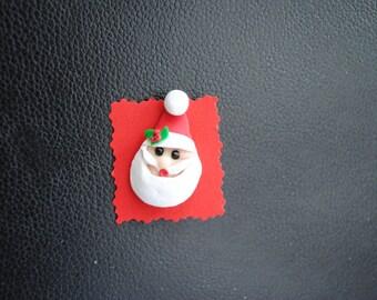 Broche en argile polymère de père Noël