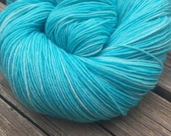Hand Dyed Sock Weight Yarn Kiss From a Mermaid turquoise Hand Painted sock yarn 463 yards hand dyed superwash merino nylon yarn teal swm