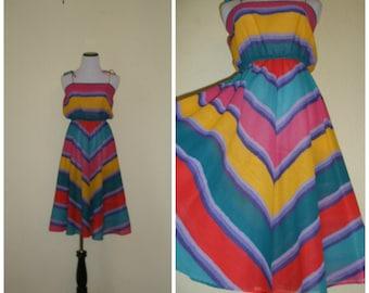 70s-80s sundress.  Halter dress with chevron stripes in sea green, yellow, purple, full skirt, blousy upper. Size S-M.