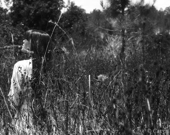 Blending In - FREE SHIPPING Black & White Surreal Photo Print Portrait Girl in grass slowly disappearing Creepy Dark Art Wall Goth Gray