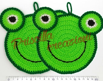 Pair of handmade pot holders made from crochet in the shape of a frog