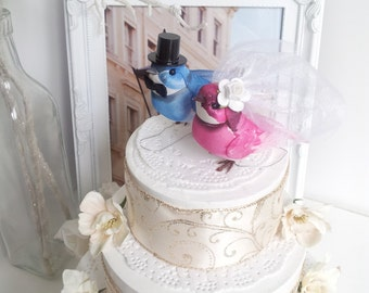 pink and  blue wedding love birds cake topper