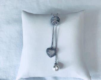 Sterling silver necklace with cubic zirconia .