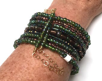 Green Glass Cuff Bracelet. 9 Layers. Stacked Bangle. Memory Wire Bracelet. Bangle Bracelet. Approx. 7.5 inch.