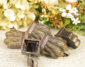 Set of five antique claw foot castors or casters for furniture restoration