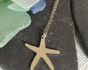 Sterling Silver Starfish pendant, hand sawed, and textured.