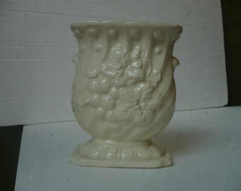 Ceramic Vase with a Grape and Grape Vine design.