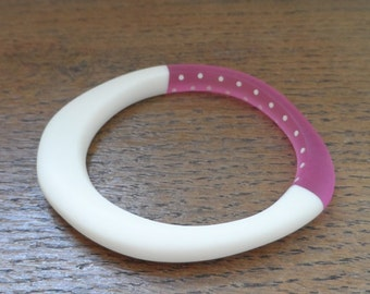 White wangle bangle with pink cut out and white dots
