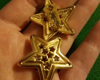 Vintage star earrings with star cutwork gold plated or tone clip one great condition