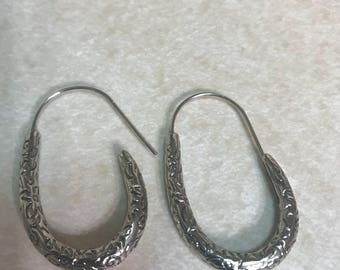Heavy silver tone elingated hammered hoops