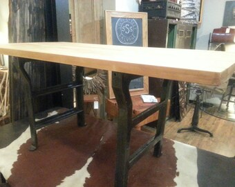 Vintage industrial work table with cast iron legs