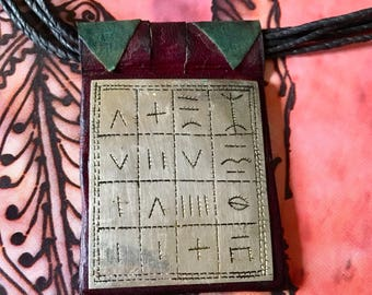 Tuareg Gri Gri AMULET with Tifinagh signs, the alphabet of the Tuareg people on dark Red Leather, incl. Tuareg Leather Necklace