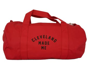 Red Duffel Bag with 'Cleveland Made Me' in Black Ink