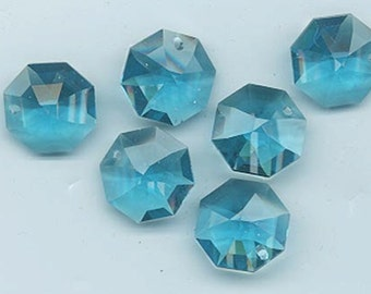Four Swarovski Strass lily octagons - Art. 8115 - 14 mm - fabulous color indicolite - Strass logo!