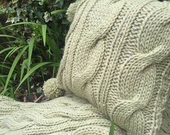 Hand knit cable cushion, in sage green