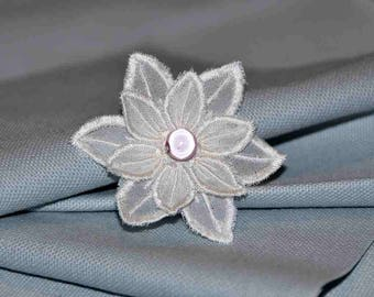Flower brooch light to brighten a garment to pin on a lapel or purse.