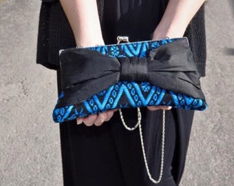 Small clutch with silk bow