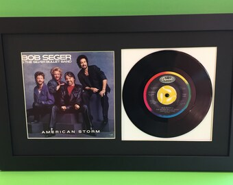 """45 Rpm record picture frame displays sleeve and 7"""" vinyl"""