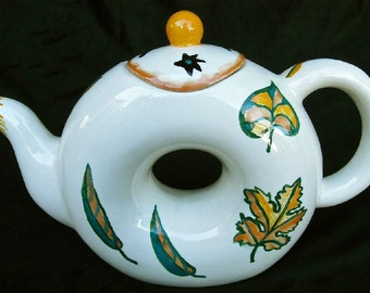 Teapot with 1 matching Cup with hand painted original autumn leaf designs.