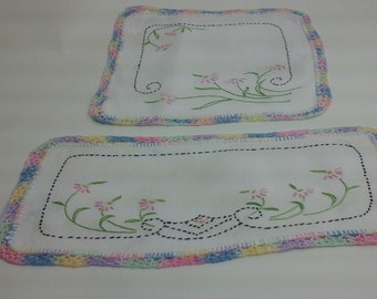 Set of floral doilies with rainbow, crochet edges