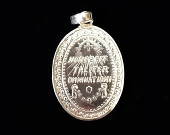 Silver Guadalupe Madonna oval medallion