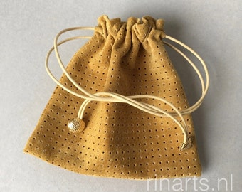 Leather drawstring pouch / drawstring purse in golden yellow suede. Cosmetic pouch. Gift pouch