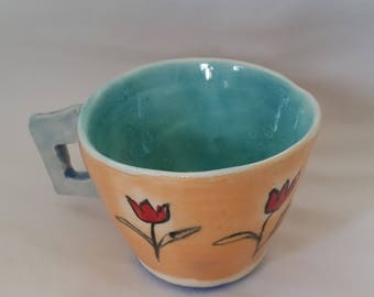 Tea cup with tulip flower