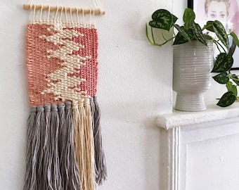 Weaving - pink, cream, and gray woven wall hanging